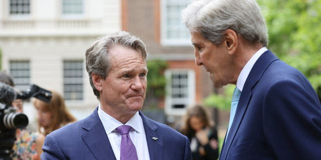 CEO of Bank of America, Brian Moynihan, left, speaks with John Kerry, the US Special Presidential Envoy for Climate, during a sustainability and G7 engagement event for Terra Carta Transition Coalitions, an organized, global collective working together to drive investment towards a sustainable future for Nature, People and Planet, at St James's Palace in London, Thursday, June 10, 2021. (Chris Jackson/Pool Photo via AP)