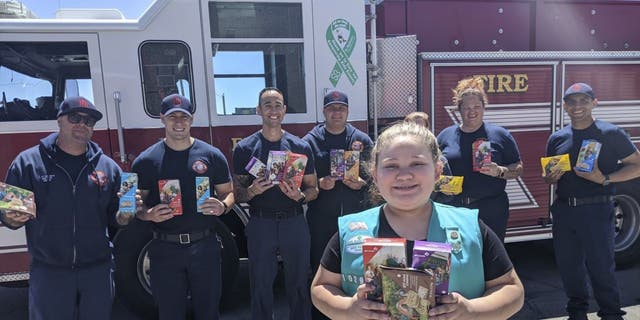 The Girl Scouts of New Mexico Trails shows donated cookies to firefighters in Rio Rancho, New Mexico, as part of their Hometown Heroes program. During the coronavirus pandemic, many Girl Scout troops nixed traditional cookie booths for safety reasons, which left millions of boxes unsold. (Girl Scouts of New Mexico Trails via AP)