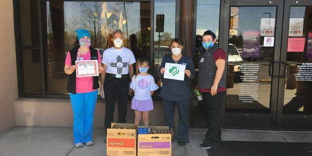 The Girl Scouts of New Mexico Trails visited health care workers at Christus St. Vincent Health System in Santa Fe, New Mexico, in April. The troop donated cookies to the health center as part of their Hometown Heroes program. (Girl Scouts of New Mexico Trails via AP)