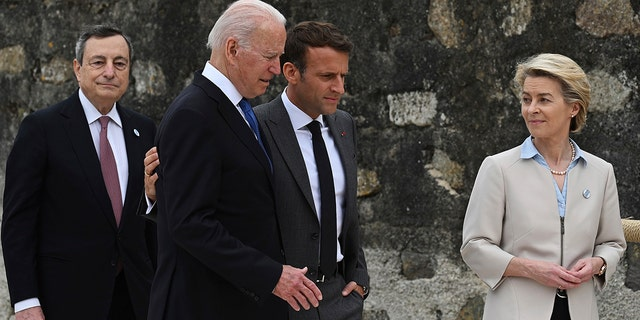 From left, Italian Prime Minister Mario Draghi, U.S. President Joe Biden, French President Emmanuel Macron and European Commission Ursula von der Leyen gather during the G-7 Summit, in Carbis Bay, Cornwall, England, Friday, June 11, 2021. (Associated Press)