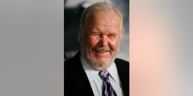 """In this Thursday, March 8, 2007, file photo, actor Ned Beatty arrives at the premiere of the movie """"Shooter,"""" in Los Angeles."""