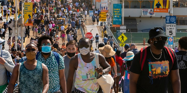 FILE - In this Saturday, May 29, 2021, file photo, people crowd the Santa Monica Pier in Santa Monica, Calif. California, the first state in America to put in place a coronavirus lockdown, is now turning a page on the pandemic. Most of California's coronavirus restrictions will disappear Tuesday, June 15, 2021. (AP Photo/Damian Dovarganes, File)
