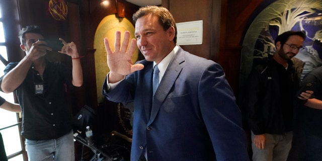 Florida Gov. Ron DeSantis, waves as he arrives, Monday, June 14, 2021, at the Shul of Bal Harbour, a Jewish community center in Surfside, Fla. (AP Photo/Wilfredo Lee)