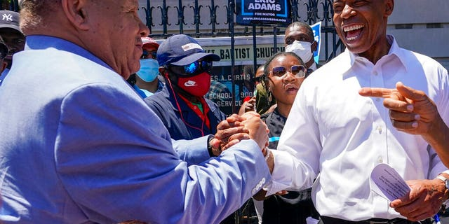 Democratic mayoral candidate Eric Adams greets supporters during a campaign event, Thursday, June 17, 2021, in the Harlem neighborhood of New York.