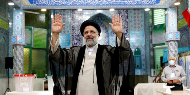 June 18, 2021: Ebrahim Raisi, a candidate in Iran's presidential elections waves to the media after casting his vote at a polling station in Tehran, Iran. (AP Photo/Ebrahim Noroozi)