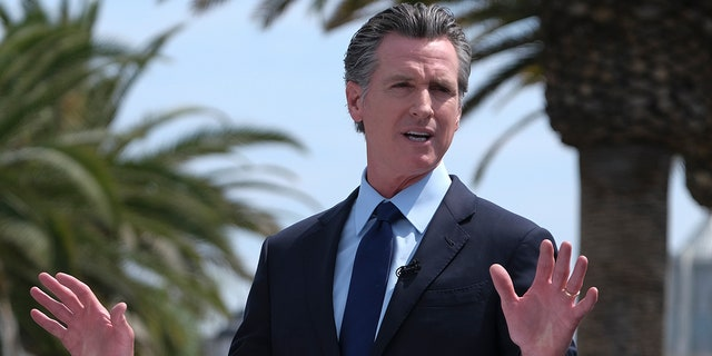California Gov. Gavin Newsom talks during a news conference at Universal Studios in Universal City, Calif. Newsom and state legislative leaders are negotiating about whether to extend the state's ban on evictions for unpaid rent on June 15, 2021. (AP Photo/Ringo H.W. Chiu, File)