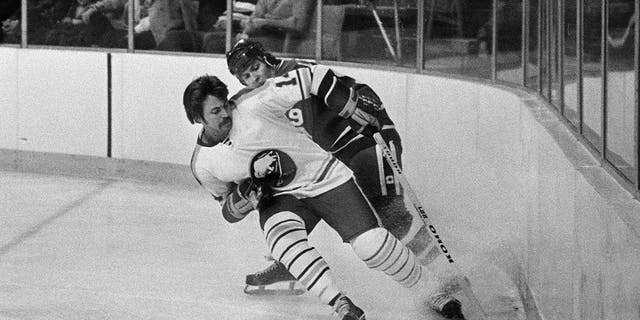 Buffalo Sabres' Rene Robert (14), front, beats Vancouver Canucks' Don Lever (9) to the puck during the first period of an NHL hockey game in Buffalo, N.Y on Dec. 12, 1977. (Associated Press)