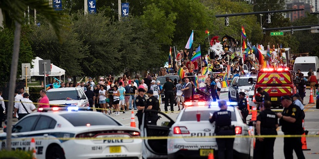 Police and firefighters respond after a truck drove into a crowd of people injuring them during The Stonewall Pride Parade and Street Festival in Wilton Manors, Fla., on Saturday, June 19, 2021. (Associated Press)