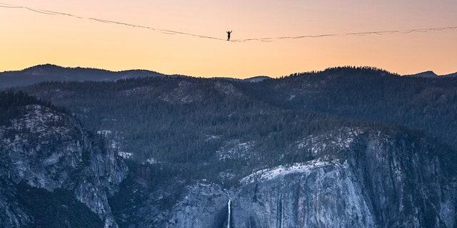 Highliner Daniel Monterrubio walks the 2,800-foot-long line off Taft Point above Yosemite Valley in Yosemite, Calif on June 12, 2021. (Scott Oller/Scott Oller Films via AP)
