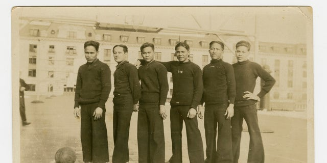 In this 1926 photo provided by the Filipino American Community Archives Rita M. Cacas, University of Maryland, Filipino sailors in athletic uniforms at the US Naval Academy in Annapolis, Maryland.  Asian Americans, veterans and civilians in the United States and the Philippines campaign to name a Navy warship for a Filipino sailor who bravely rescued two crew members when their ship caught fire over a century ago, which earned him a prestigious and rare Medal of Honor.  (Rita M. Cacas Filipino American Community Archives, University of Maryland via AP)