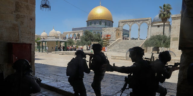 Israeli security forces take positions during clashes with Palestinians in front of the Dome of the Rock Mosque at the Al Aqsa Mosque compound in Jerusalem's Old City on June 18, 2021. (AP Photo/Mahmoud Illean, File)