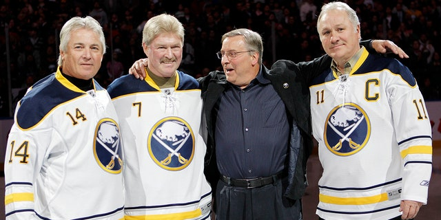"""Buffalo Sabres owner Terry Pegula, second from right, poses with former """"French Connection"""" linemates Rene Robert (14), Rick Martin (7), and Gilbert Perreault (11) before an NHL hockey game against the Atlanta Thrashers in Buffalo, N.Y on Feb. 23, 2011. (Associated Press)"""