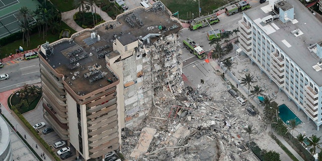 This aerial view shows a portion of the oceanfront 12-story Champlain Towers South Condo that collapsed in Surfside, Florida early Thursday, June 24, 2021.