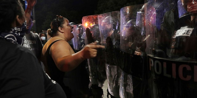 Crystal Bryan of Sumter, S.C. confronts Rock Hill police Wednesday, June 23, 2021, in downtown Rock Hill, S.C. (Associated Press)