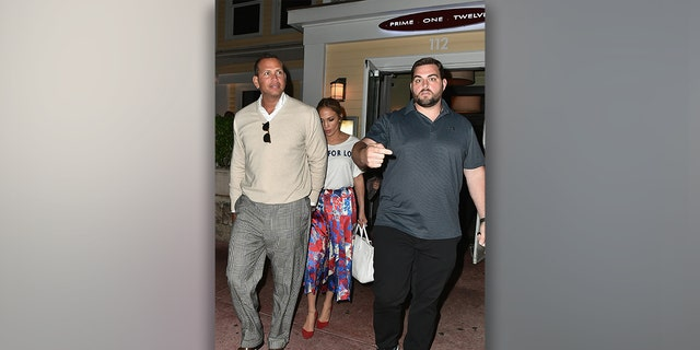 MIAMI, FL - APRIL 18: (Exclusive Coverage) Alex Rodriguez and Jennifer Lopez leave after dinner at Prime 112 Steakhouse on April 18, 2017 in Miami, Florida.  (Photo by Gustavo Caballero / GC Images)