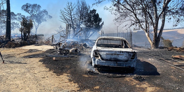 A car burned in northern California in Intanko Fire is sitting on burned ground.  (Credit: Cal Fire)