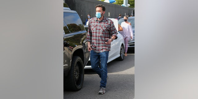 Affleck was previously photographed wearing the red and grey flannel. (Photo by Bellocqimages/Bauer-Griffin/GC Images)