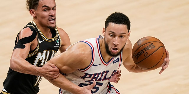 Atlanta Hawks' Trae Young (11) fouls Philadelphia 76ers' Ben Simmons (25) during the first half of Game 4 of a second-round NBA basketball playoff series on Monday, June 14, 2021, in Atlanta.