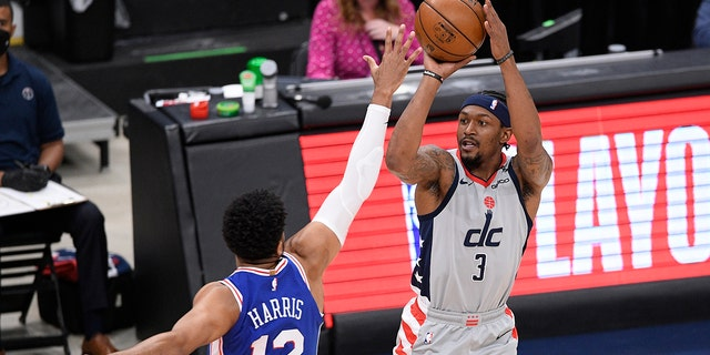 Washington Wizards guard Bradley Beal (3) shoots against Philadelphia 76ers forward Tobias Harris (12) during the first half of Game 4 in a first-round NBA basketball playoff series, Monday, May 31, 2021, in Washington. (AP Photo/Nick Wass)