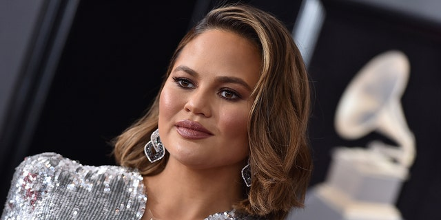 Chrissy Teigen reveals new ink honoring daughter's pre-school graduation in first post after apology.jpg