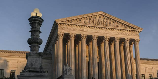 In this Nov. 6, 2020, file photo, the Supreme Court is seen at sundown in Washington. The justices heard arguments inside the courtroom for the first time in more than a year-and-a-half of Monday. (AP Photo/J. Scott Applewhite, File)