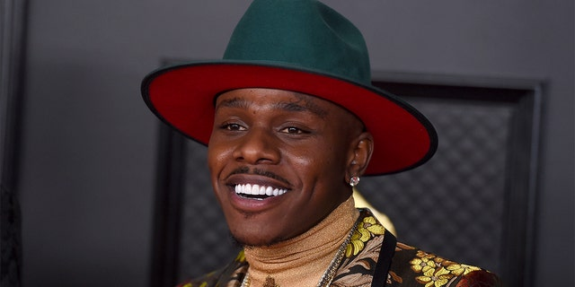 FILE - In this Sunday, March 14, 2021 file photo, DaBaby arrives at the 63rd Annual Grammy Awards at the Los Angeles Convention Center.  Grammy-nominated rapper DaBaby is being questioned by Miami Beach police, officials said on Tuesday, June 1, 2021.  He is one of several people being questioned by authorities on Tuesday.  No arrests have been made.  (Photo by Jordan Strauss/InVision/AP, FILE)