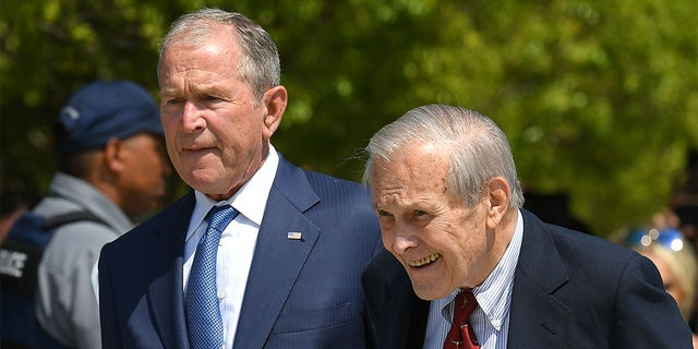 Former President George W. Bush and Defense Secretary Donald Rumsfeld attend a ceremony to mark the 18th anniversary of the 9/11 attacks, on Sept. 11, 2019, at the Pentagon in Washington, DC.