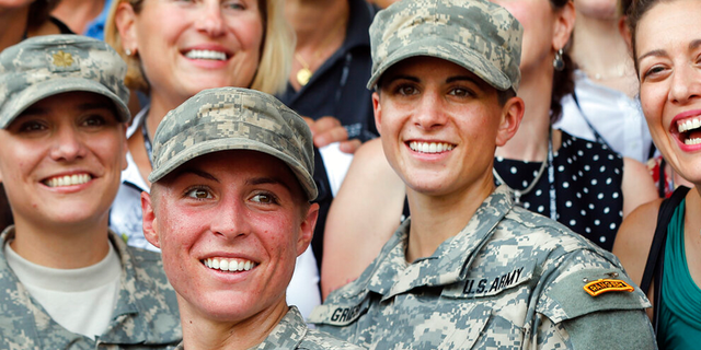FILE: Army 1st Lt. Shaye Haver, center, and Capt. Kristen Griest, right, pose for photos with other female West Point alumni after an Army Ranger school graduation ceremony at Fort Benning, Ga. Haver and Griest became the first female graduates of the Army's rigorous Ranger School.