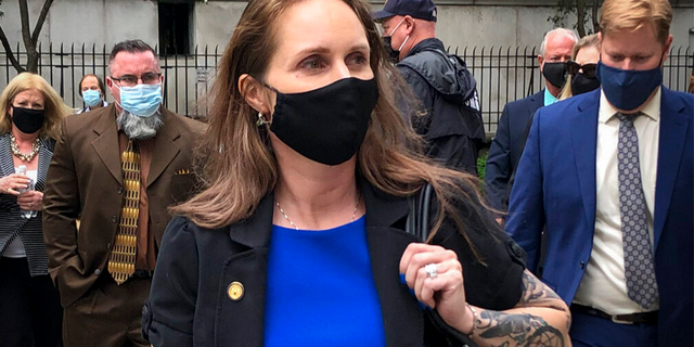 Natalie Mayflower Sours Edwards, center, leaves court after receiving a six-month prison sentence for leaking confidential financial reports to a journalist at Buzzfeed, Thursday June 3, 2021, in New York.
