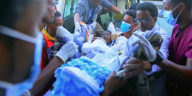 In this image made from video, an injured victim of an alleged airstrike on a village arrives in an ambulance at the Ayder Referral Hospital in Mekele, in the Tigray region of northern Ethiopia, Wednesday, June 23, 2021. (AP Photo)