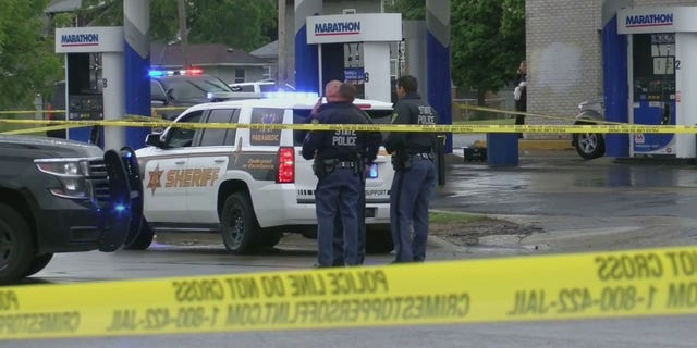 Photos showed a heavy police presence at a gas station in Flint following an officer-involved shooting Saturday afternoon.