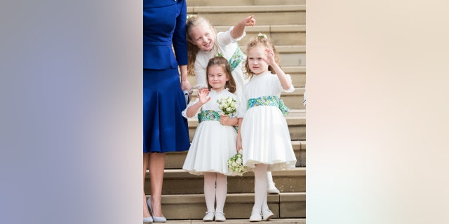 Van links: Bridesmaids Princess Charlotte of Cambridge, Savannah Phillips and Maud Windsor after the wedding of Princess Eugenie of York and Jack Brooksbank at St. George's Chapel on October 12, 2018, in Windsor, Engeland.