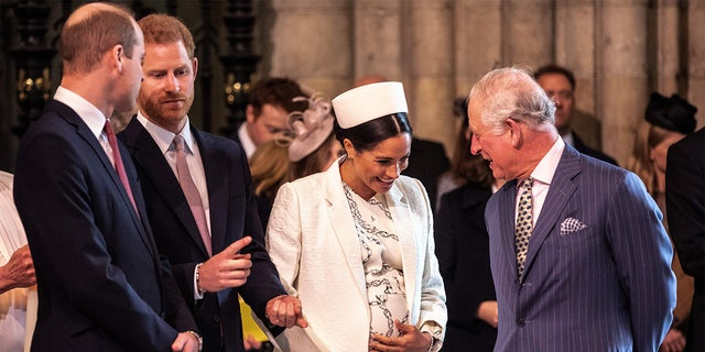 Britain's Meghan, Duchess of Sussex (2R) chats with Britain's Prince Charles, Prince of Wales (R) as Britain's Prince William, Duke of Cambridge, (L) speaks with Britain's Prince Harry, Duke of Sussex, (2L) as they all attend the Commonwealth Day service at Westminster Abbey in London on March 11, 2019.