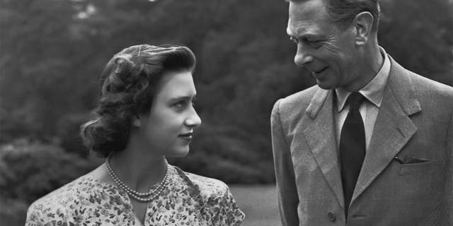 Princess Margaret (1930 - 2002) with her father King George VI (1895-1952) on the grounds of Windsor Castle in Windsor, England on July 8, 1946.