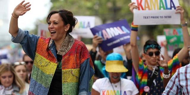 Then-presidential candidate U.S. Sen. Kamala Harris, D-Calif., waves to the crowd as she rides in a car during the San Francisco Pride Parade on June 30, 2019. (Getty Images)