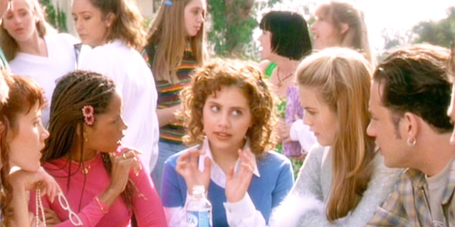 'Cluless' was written and directed by Amy Heckerling. Seen here seated from left, Elisa Donovan (as Amber), Stacey Dash (as Dionne), Brittany Murphy (as Tai, in center), Alicia Silverstone (as Cher Horowitz) and Joseph D. Reitman (as Student).
