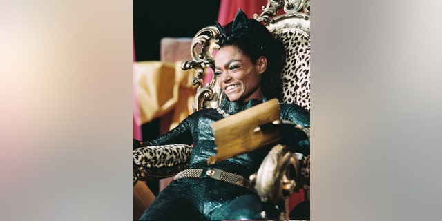 Eartha Kitt (1927-2008), US actress and singer, in costume sitting in a leopard skin covered chair in a publicity still issued for the US television series, 'Batman', USA, circa 1968. The series starred Kitt as 'Catwoman.'