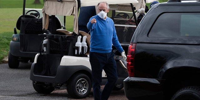 Counselor to the President Steve Ricchetti (C) gestures after playing a round of golf with US President Joe Biden at Wilmington Country Club in Wilmington, Delaware on April 17, 2021. (Photo by JIM WATSON/AFP via Getty Images)