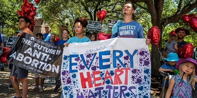 Pro-life protesters stand near a gate outside the Texas Statehouse on May 29, 2021 in Austin. (Getty Images)