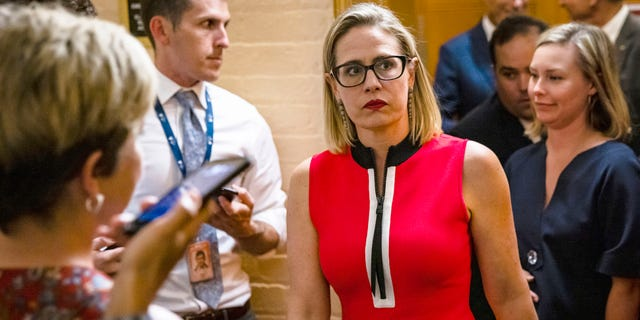 Sen. Kyrsten Sinema, D-Ariz., heads back to a bipartisan meeting on infrastructure in the basement of the U.S. Capitol building after the original talks fell through with the White House on June 8, 2021, in Washington, D.C. Sinema wrote in the Washington Poston Monday that she supports the 60-vote filibuster threshold for bills in the Senate. (Samuel Corum/Getty Images)