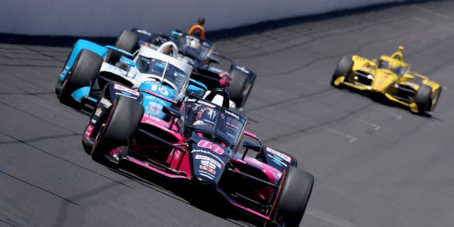 Helio Castroneves battled with Alex Palou in the closing laps of the Indy 500.