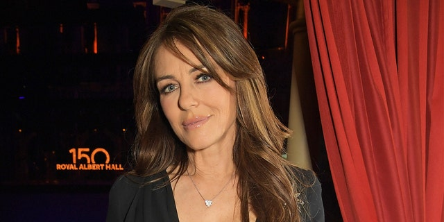 Elizabeth Hurley stunned in a seafoam-green one-piece while promoting her own swimwear line.