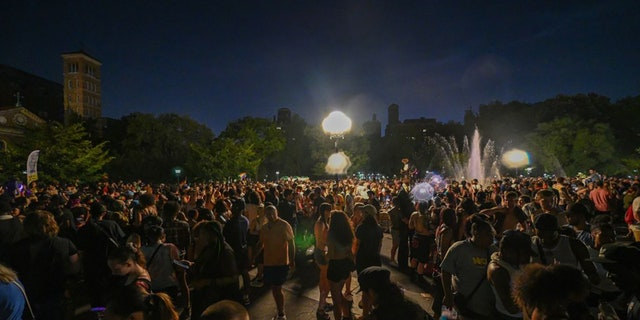 NEW YORK, NEW YORK - JUNE 27: Thousands of people celebrate Pride at night in Washington Square Park on June 27, 2021, in New York City. (Photo by Alexi Rosenfeld/Getty Images)