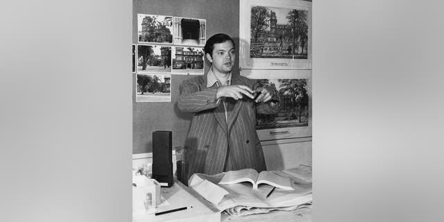 American actor, writer, director and producer Orson Welles (1915 - 1985) with production artwork for his film 'The Magnificent Ambersons', circa 1942.