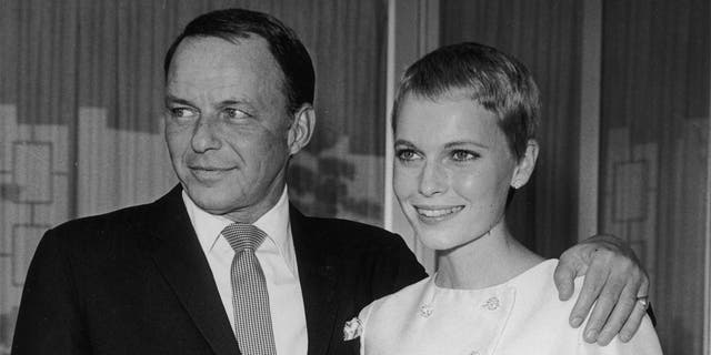 American singer Frank Sinatra (1915 - 1998) stands with his arm around his third wife, actor Mia Farrow, during their private wedding in Las Vegas, Nevada.