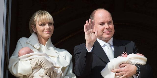 Prince Albert II of Monaco and Princess Charlene of Monaco present twins Princess Gabriella of Monaco and Prince Jacques of Monaco at the Palace Balcony on January 7, 2015 in Monaco, Monaco.