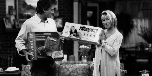 Suzanne Somers showing Patrick Duffy her ThighMaster in an episode of 'Step By Step,' circa 1993.