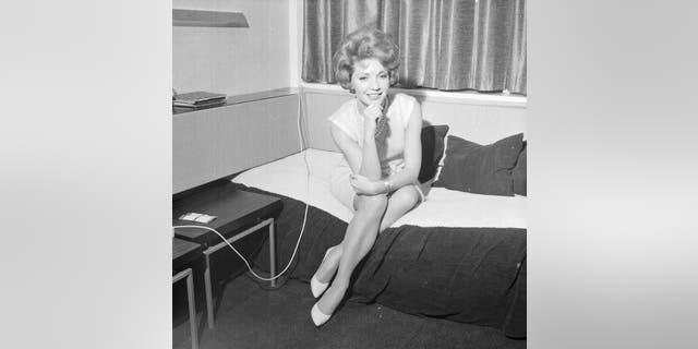 Portrait of actress Ruta Lee in her London hotel room, 1964.