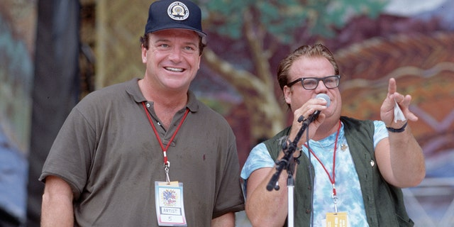 Chris Farley (right) and Tom Arnold on the stage at the 25th Anniversary concert for the celebration of the original Woodstock concert.