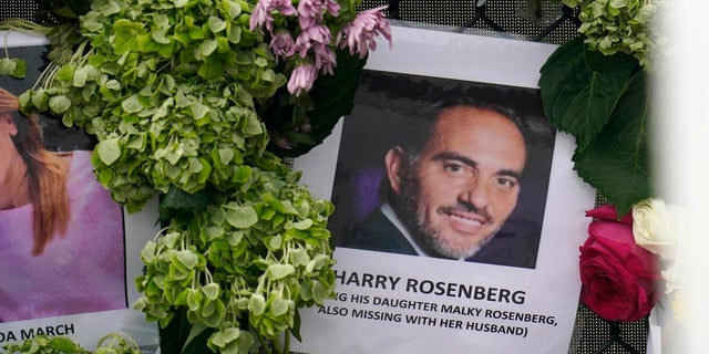 An image of Harry Rosenberg, missing since an oceanfront condo building collapsed in Surfside, Fla., hangs on a fence as part of a makeshift memorial.  (AP)